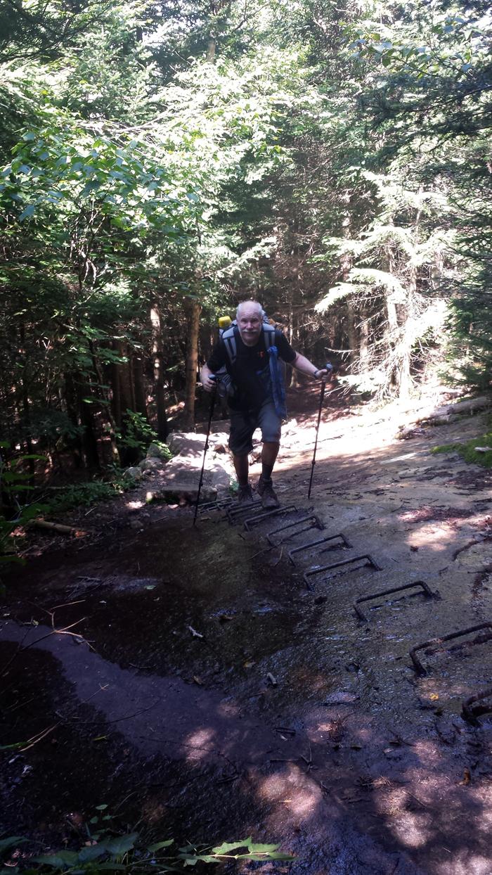 Climbing iron rungs in Lambert Ridge, NH, Day 156
